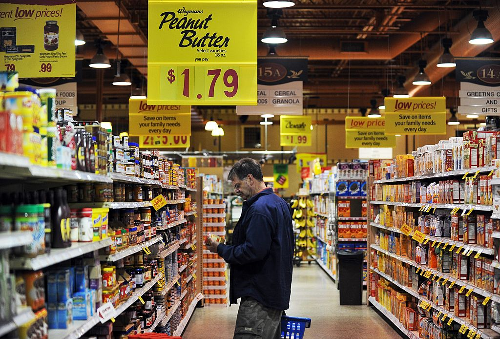 A man shops at a Wegmans supermarket.