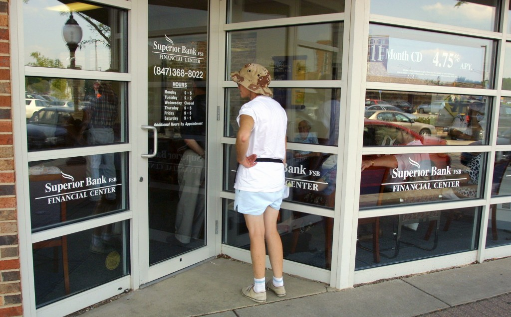 A woman looks at her bank's business hours and promptly contemplates switching to online banking