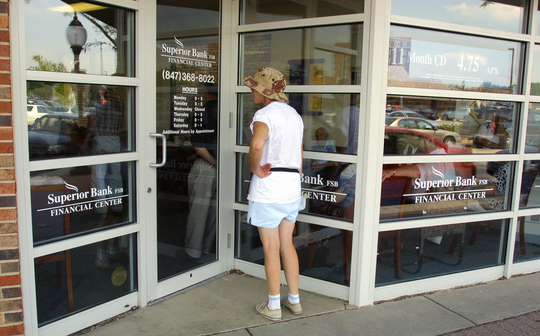 A bank customer stops at the door
