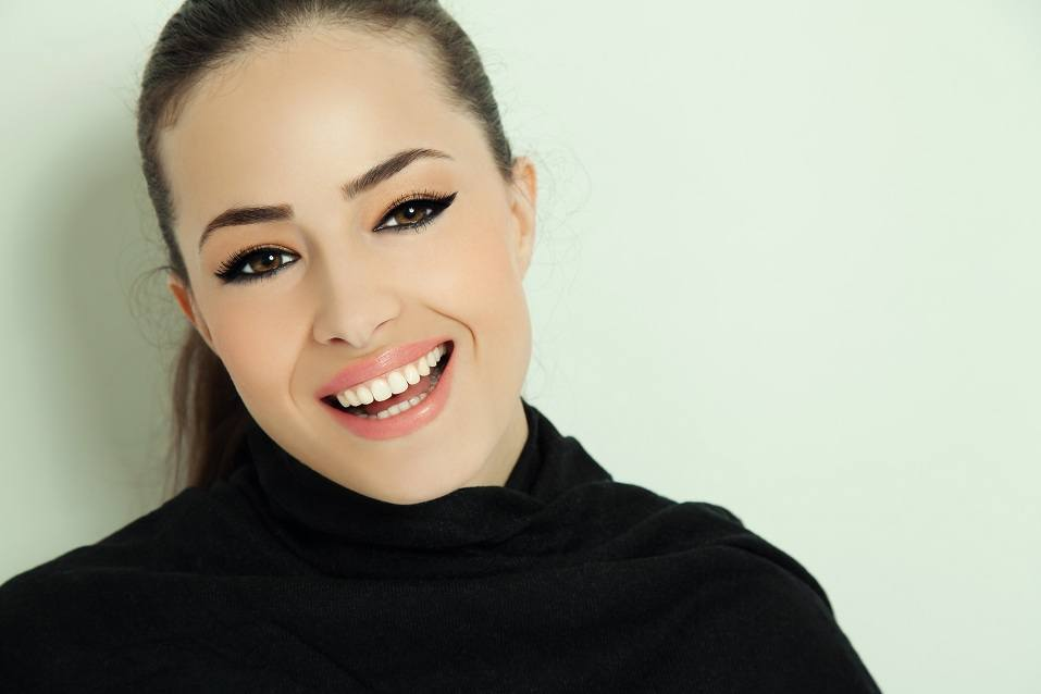 young smiling woman with elegant makeup