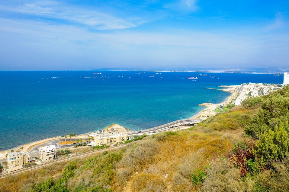 A view of sailboats in the distance in Haifa, Israel