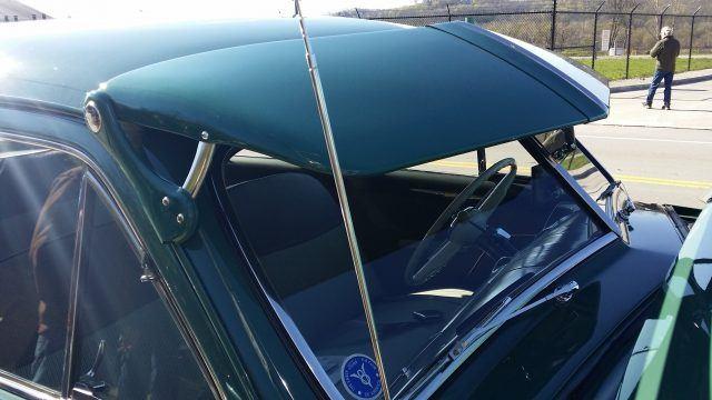 A hood visor serves as a permanently affixed sun shade