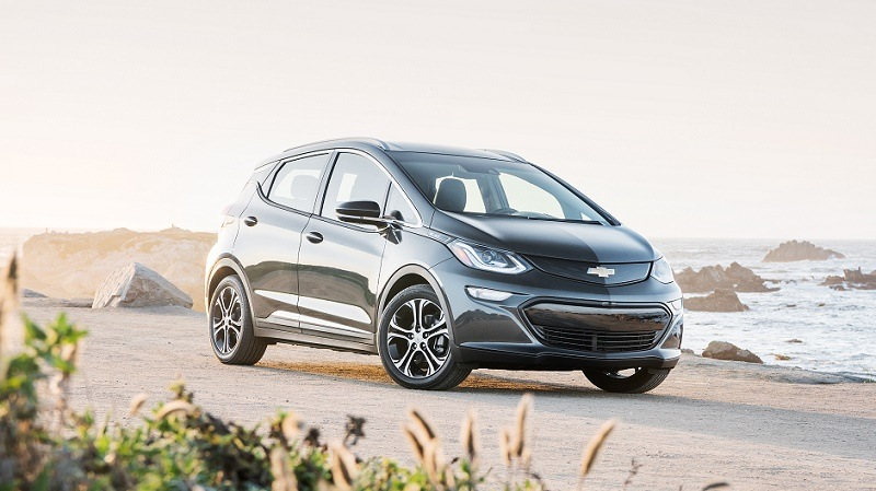 A black 2017 Chevrolet Bolt EV sits parked at the beach