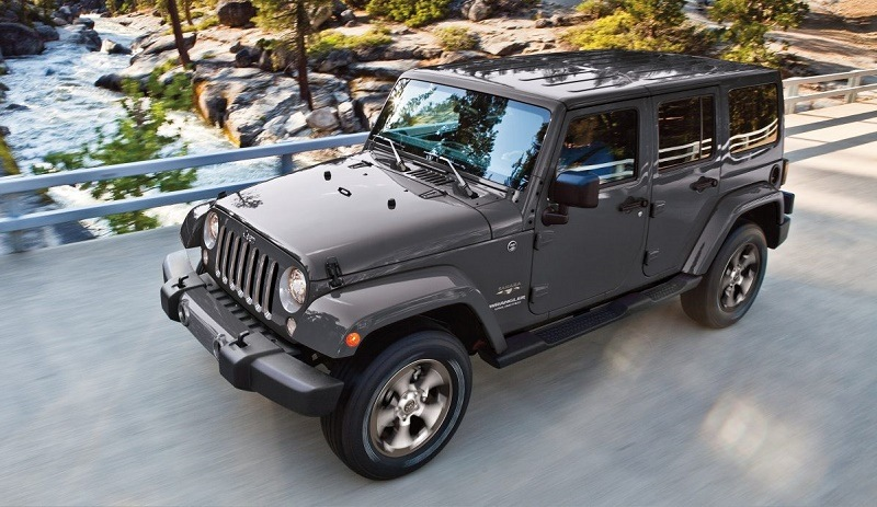 Front three-quarter view of gray 2017 Jeep Wrangler Unlimited in mountain setting