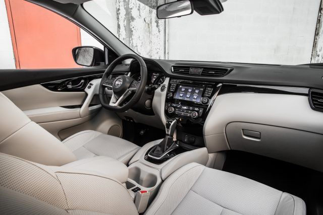The interior of the Nissan Rogue Sport looks stellar in lighter shades due to the contrasting colors across the dash and in the door panels | Nissan