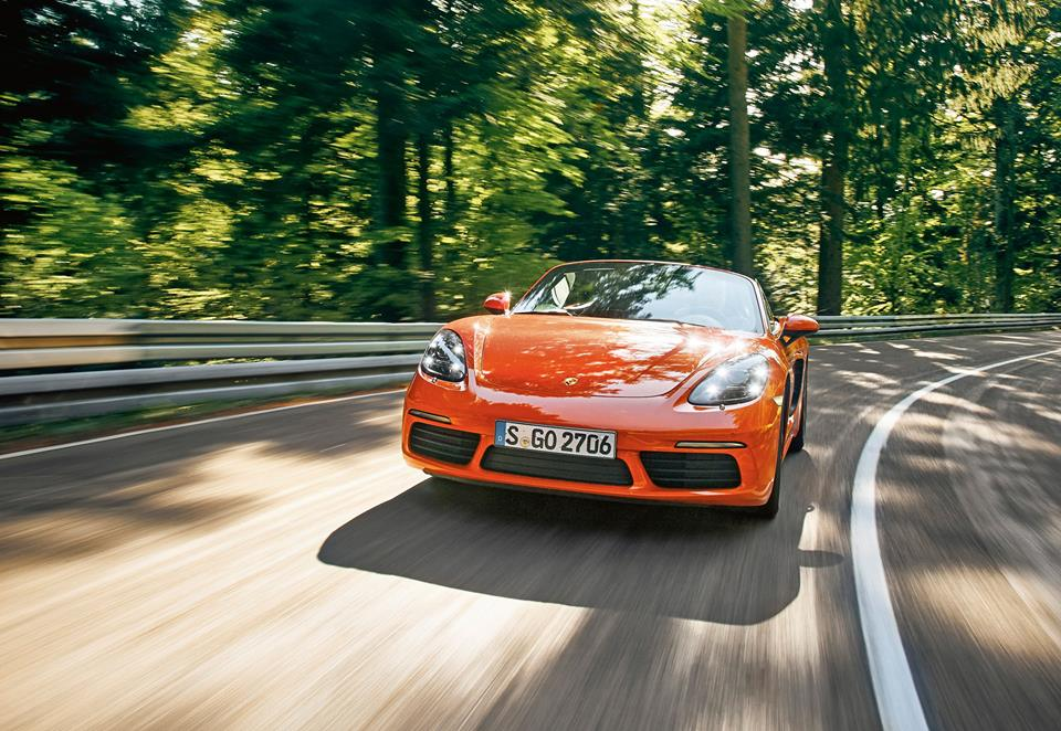 Rad shot of orange 2017 Porsche Boxster