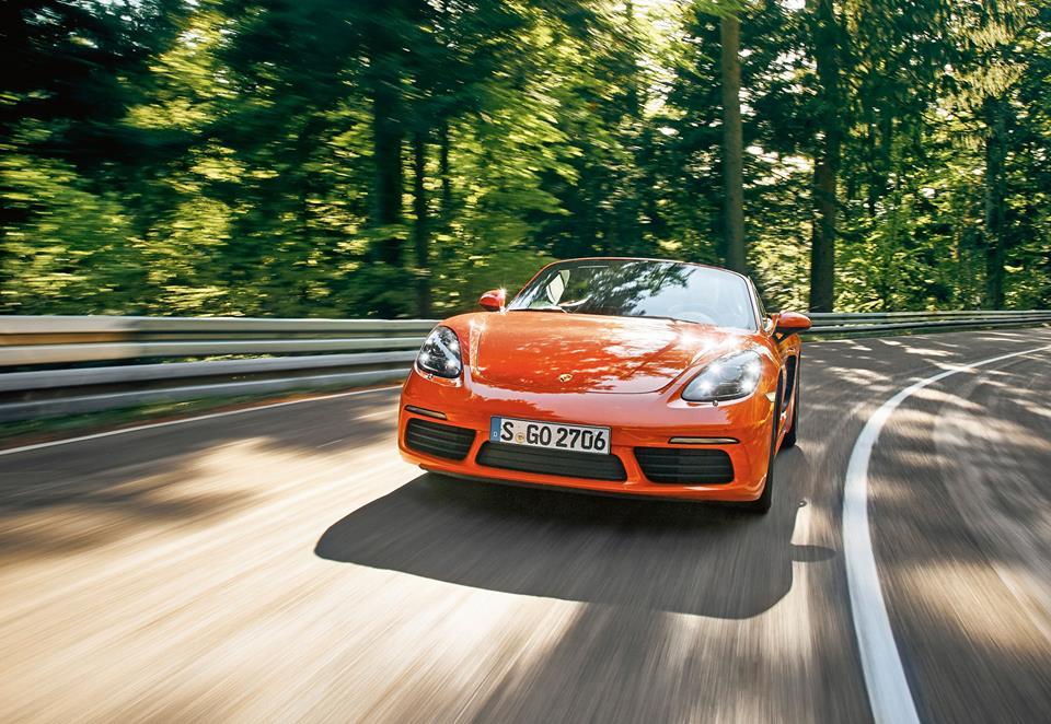 Rad shot of orange 2017 Porsche Boxster