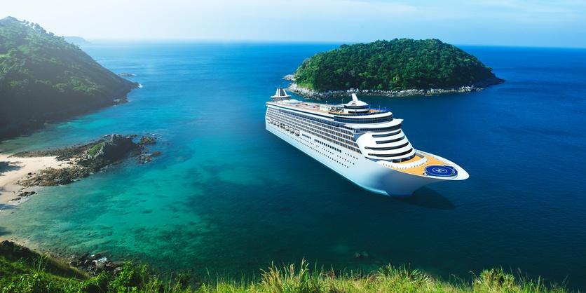 cruise ship in ocean near islands