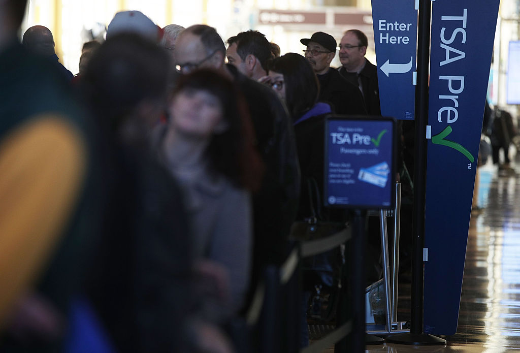 Travelers wait in a TSA Pre line for entering security check at Ronald Reagan Washington National Airport