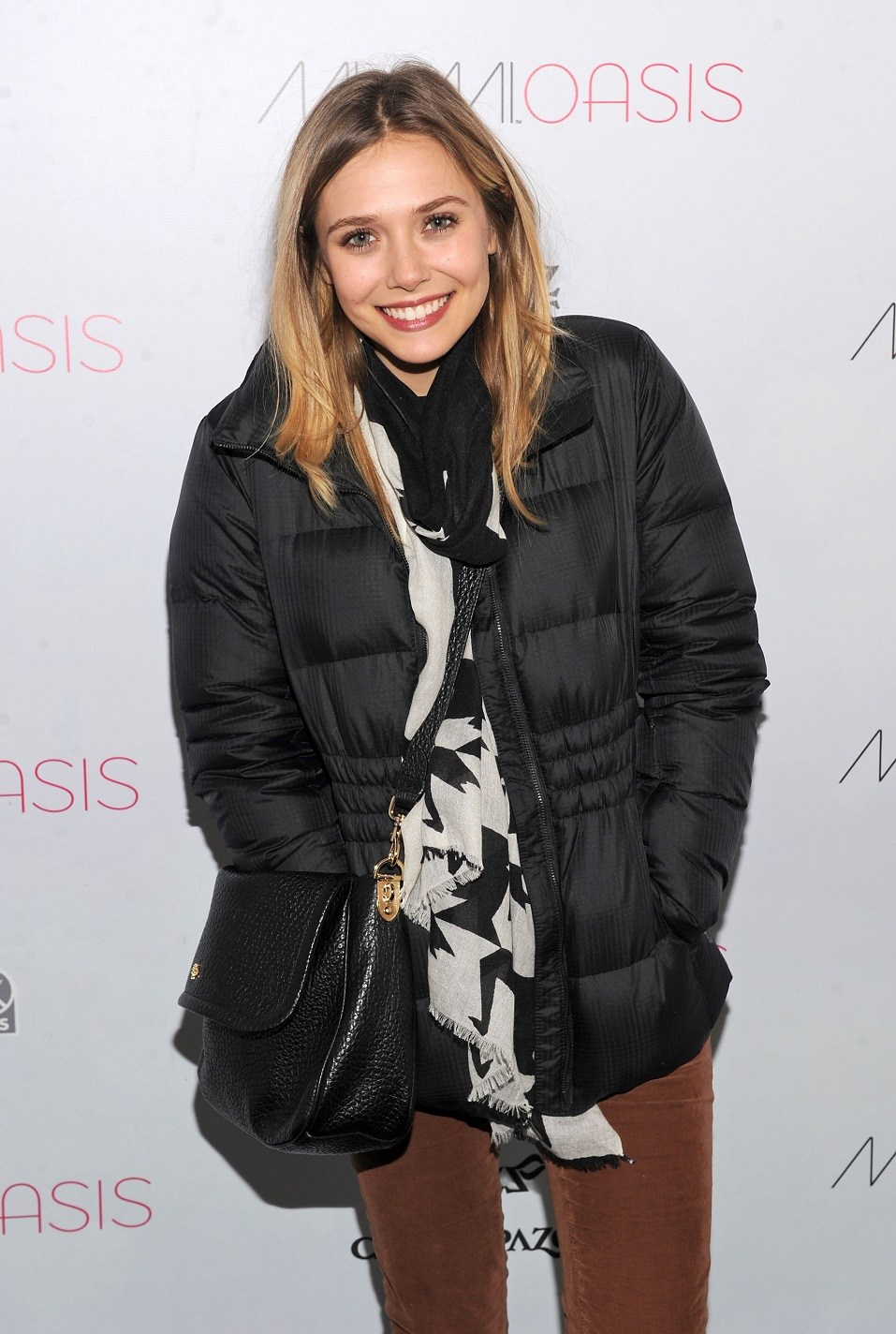Actress Elizabeth Olsen attends Day 3 of Miami Oasis