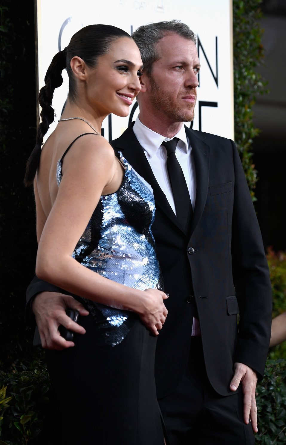 Actress Gal Gadot (L) and husband Yaron Versano attend the 74th Annual Golden Globe Awards at The Beverly Hilton Hotel