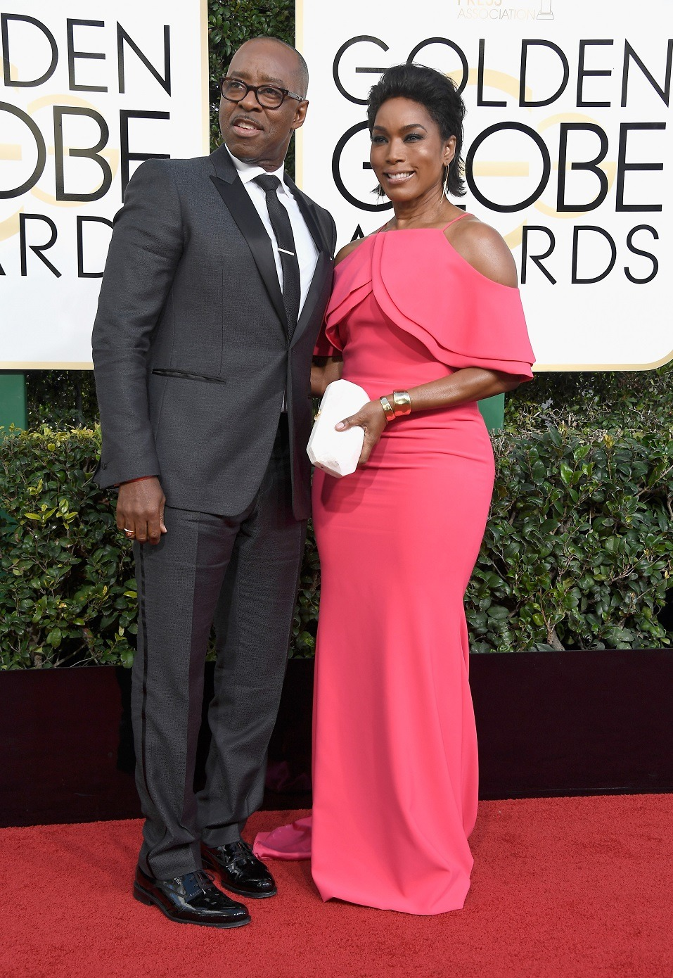 Actors Courtney B. Vance (L) and Angela Bassett attend the 74th Annual Golden Globe Awards