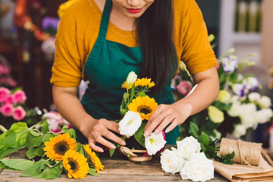 florist arranging flowers in the shop