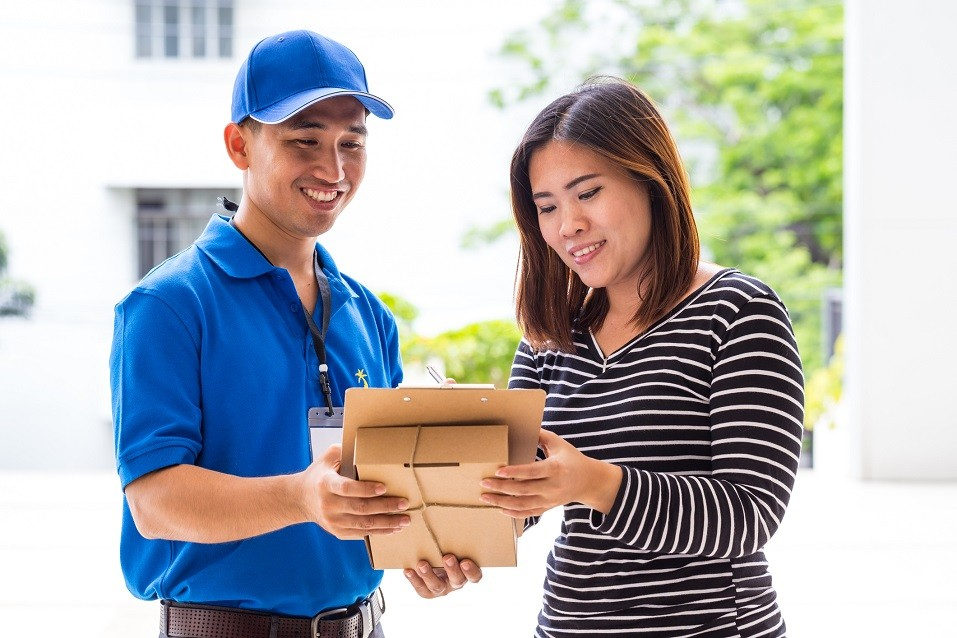 Woman signing receipt of delivered package