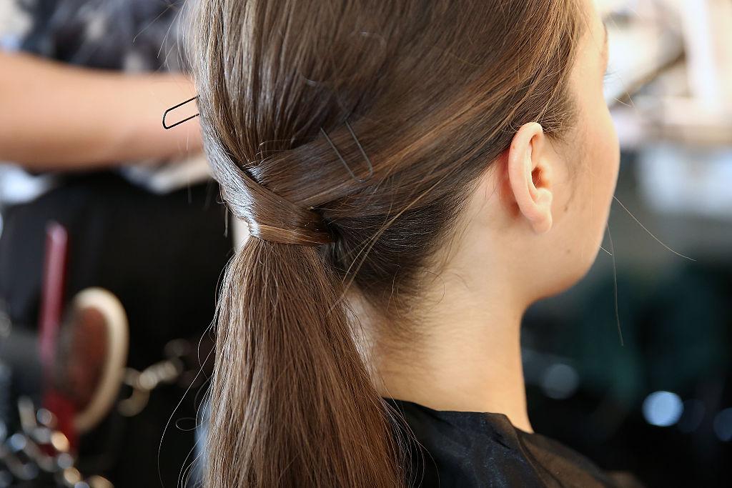 A model, hair detail, prepares backstage at the Fashion Palette Australian Womenswear fashion show