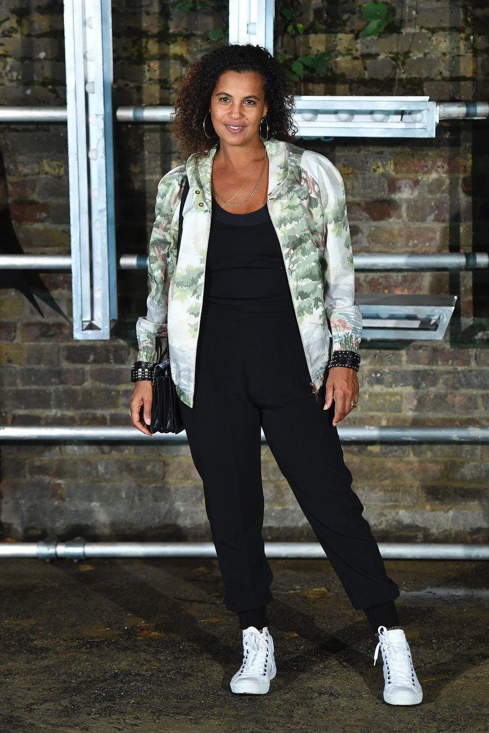 Swedish singer-songwriter Neneh Cherry poses arriving to attend the Stella McCartney menswear launch