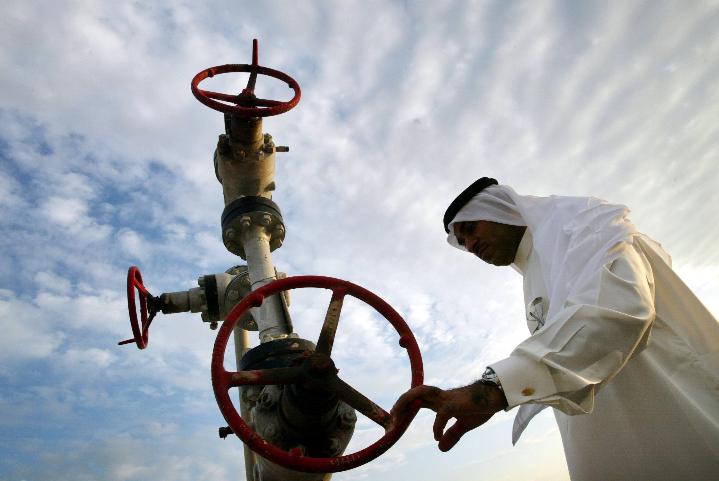 Khalid Abdulla Alhajeri looks at a natural gas pipe in Manama, Bahrain