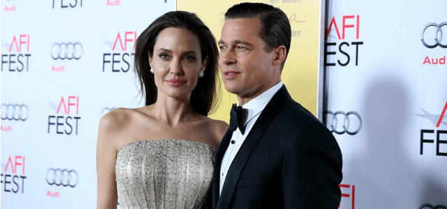 Brad Pitt and Angelina Jolie on a red carpet.
