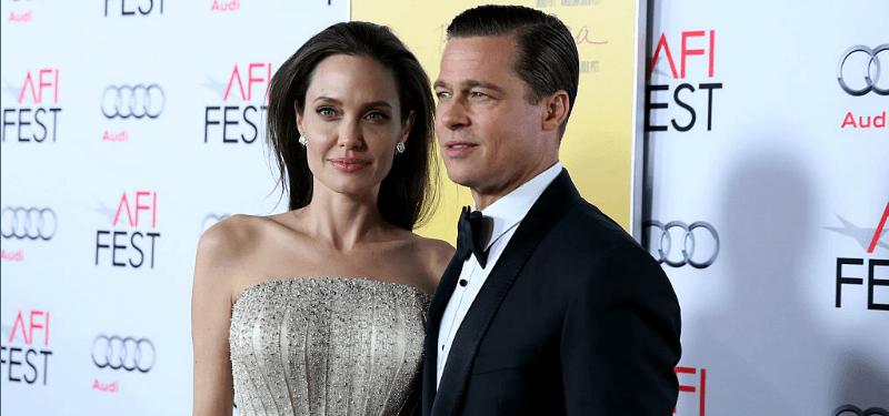 Brad Pitt and Angelina Jolie standing together