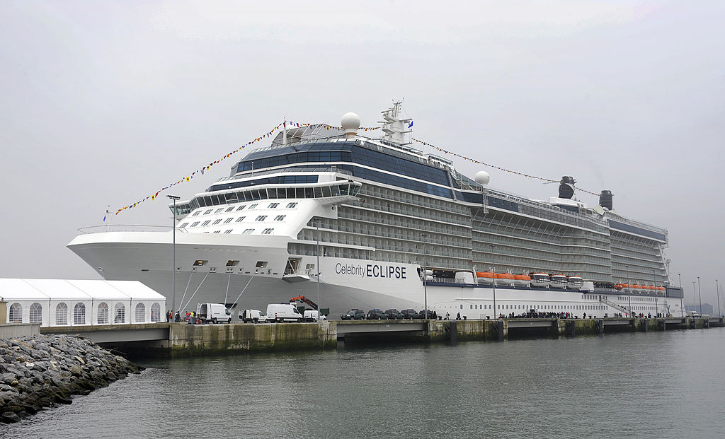 Tourists board the Celebrity Eclipse cruiser
