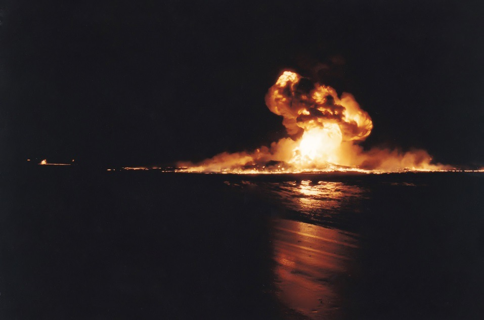 An oil well burns in the water