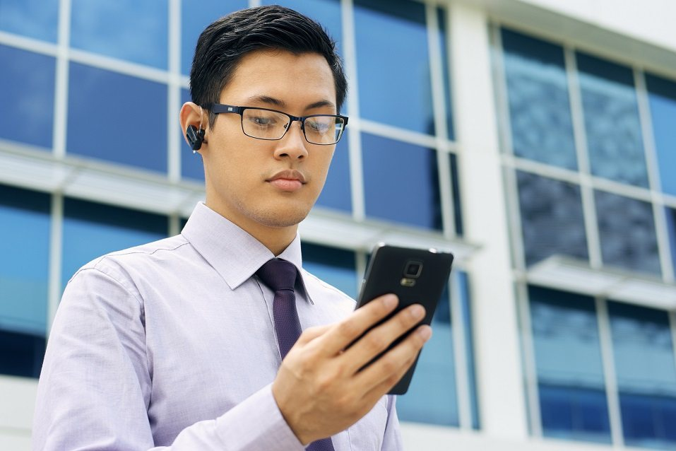 Young chinese businessman doing video conference call on smartphone
