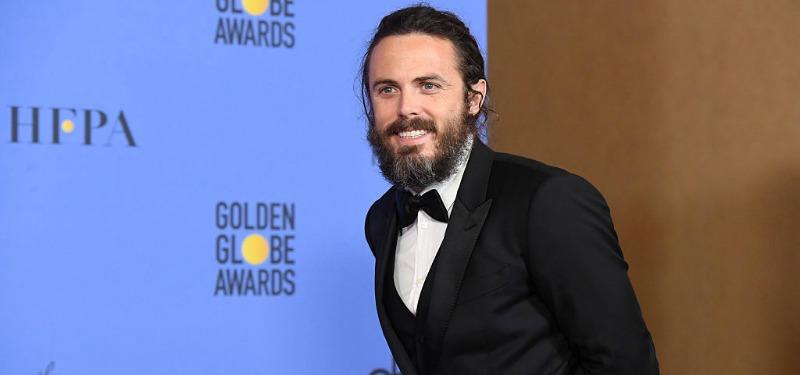 Casey Affleck poses in the press room during the 74th Annual Golden Globe Awards