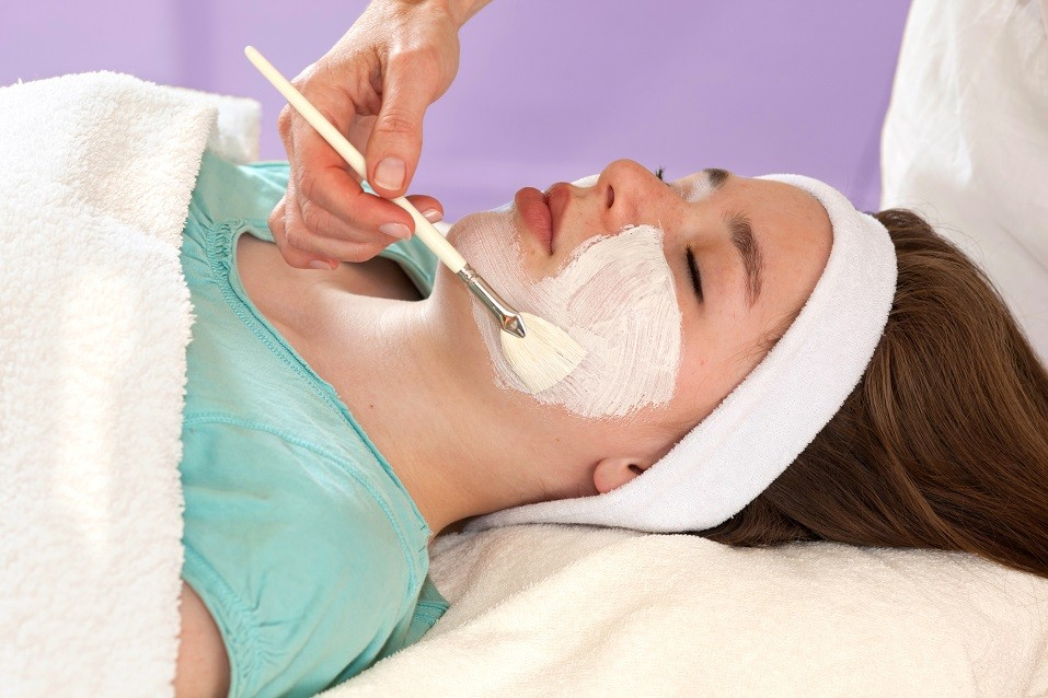 Alternative practitioner performing a chemical face peel