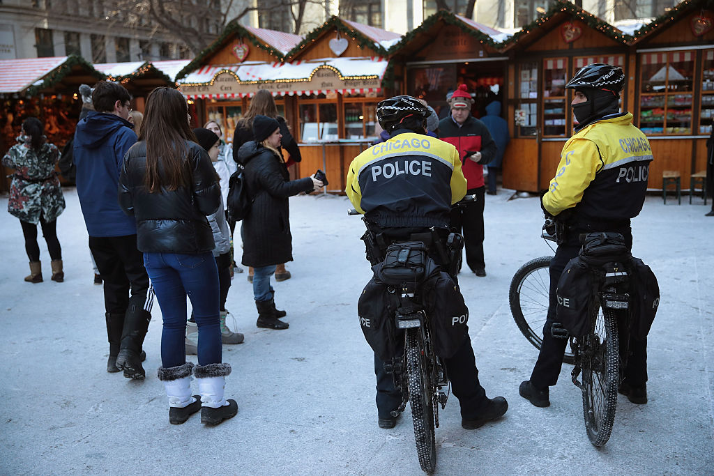 Police officers patrol at Christkindlmarket Chicago