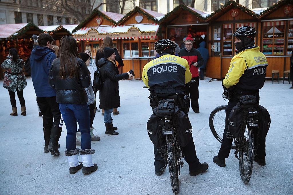 Police officers patrol at Christkindlmarket Chicago