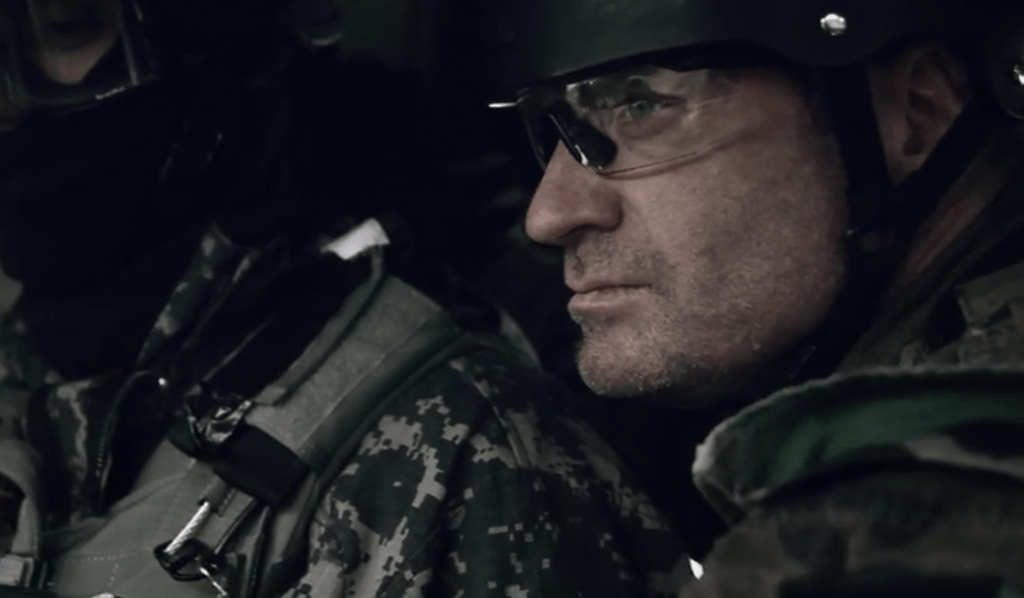Close up of a soldier wearing a helmet and protective eyewear