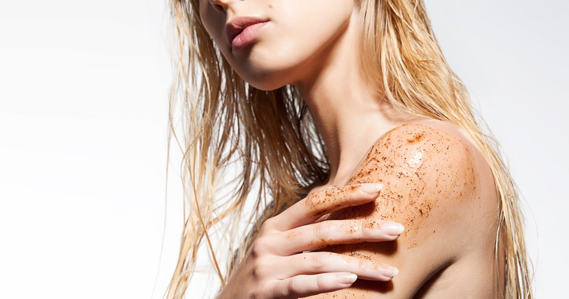 woman's shoulder with scrub of coffee