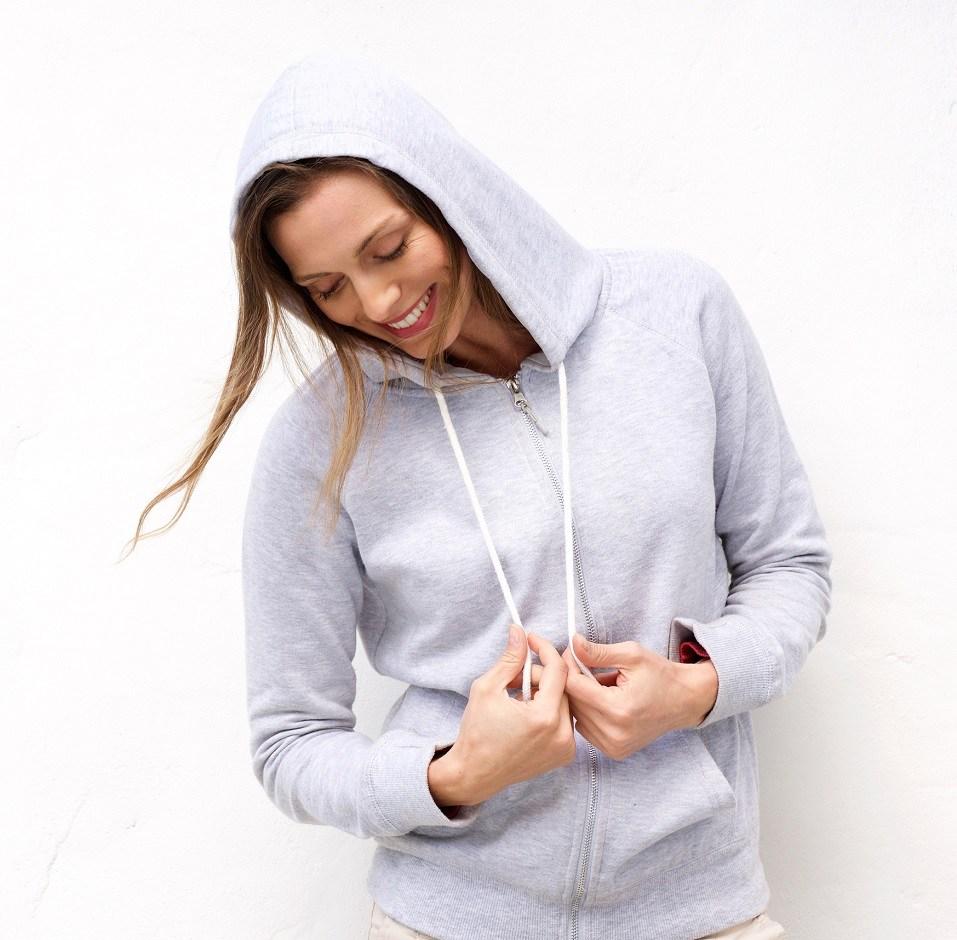 woman laughing with hood sweatshirt