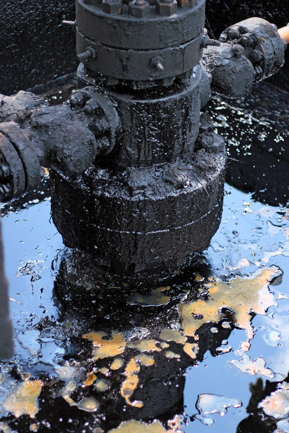 Crude oil spills around oil field