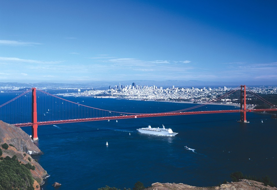 A cruise ship sails under the Golden Gate Bridge in San Francisco