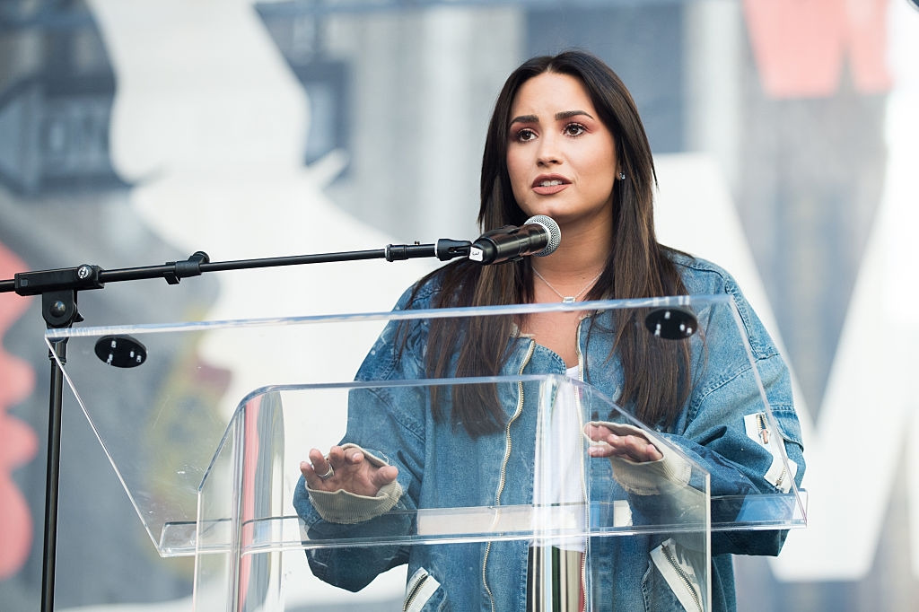 Musician Demi Lovato speaks onstage at the women's march in Los Angeles