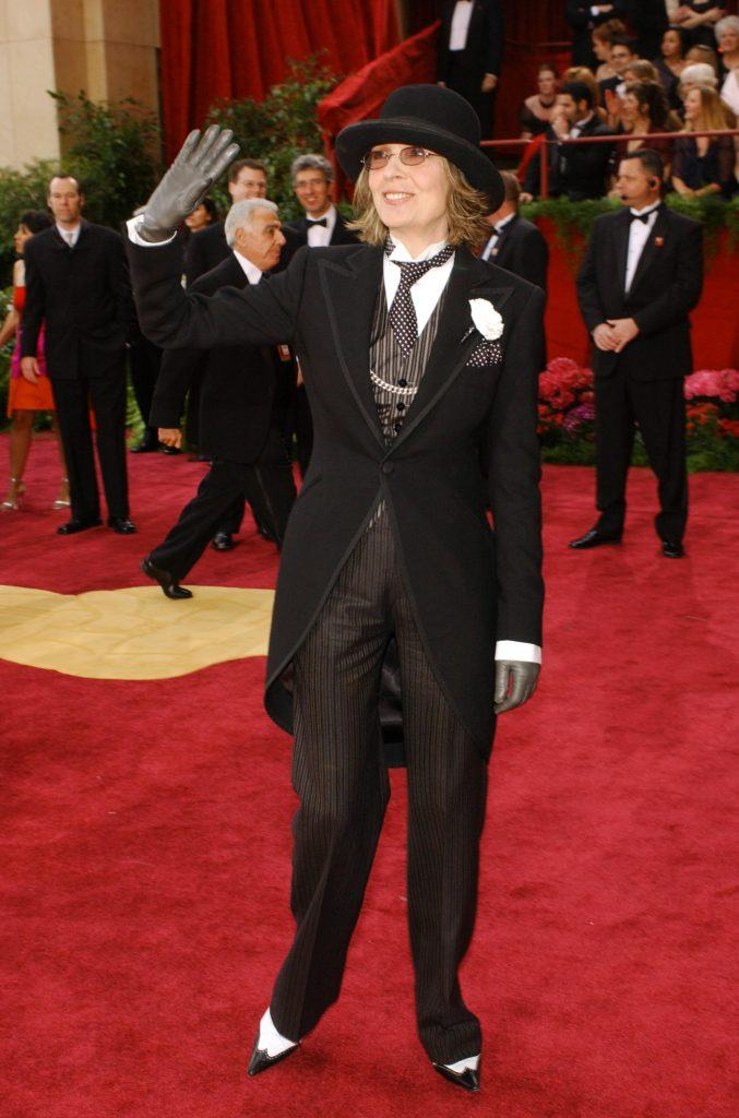Actress Diane Keaton in a full suit with a polka dot die, bowler hat, and grey gloves