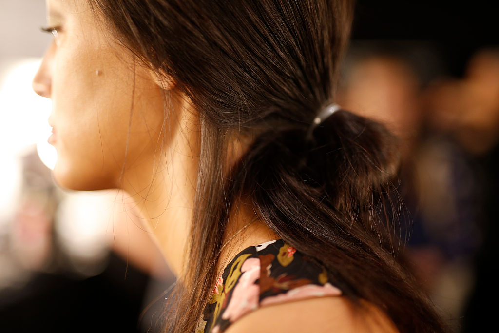 A detail shot of a Models hair is seen backstage ahead of the Dimitri show during the Mercedes-Benz Fashion Week
