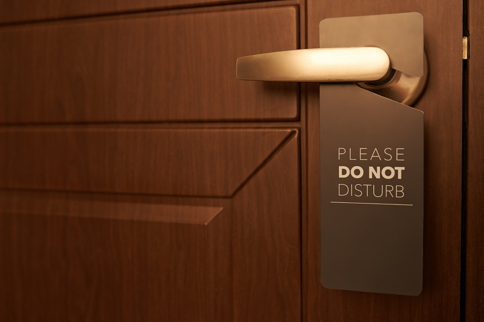 hotel door with a please do not disturb sign