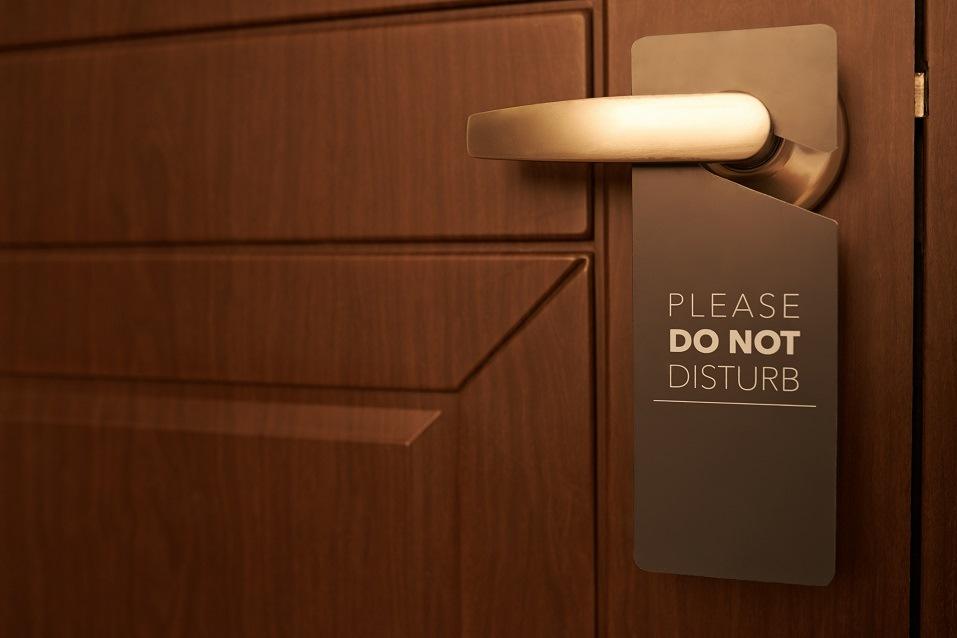 door with a please do not disturb sign