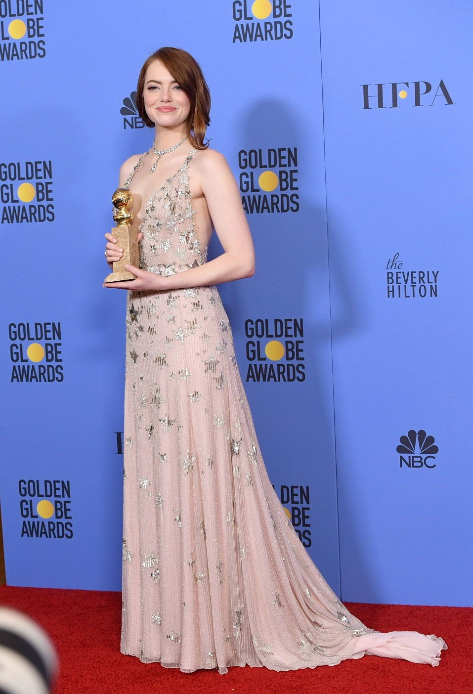Actress Emma Stone, winner of Best Actress in a Motion Picture - Musical or Comedy for 'La La Land,' poses in the press room during the 74th Annual Golden Globe Awards