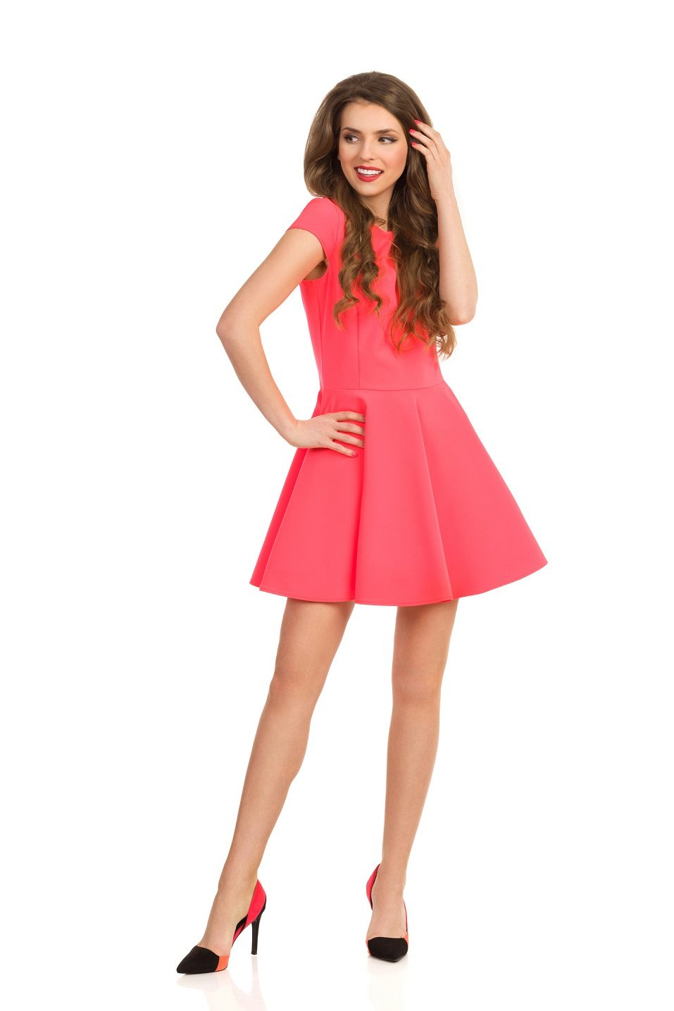 young woman in pink mini dress and high heels