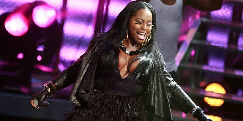 Foxy Brown performing on stage during a concert.
