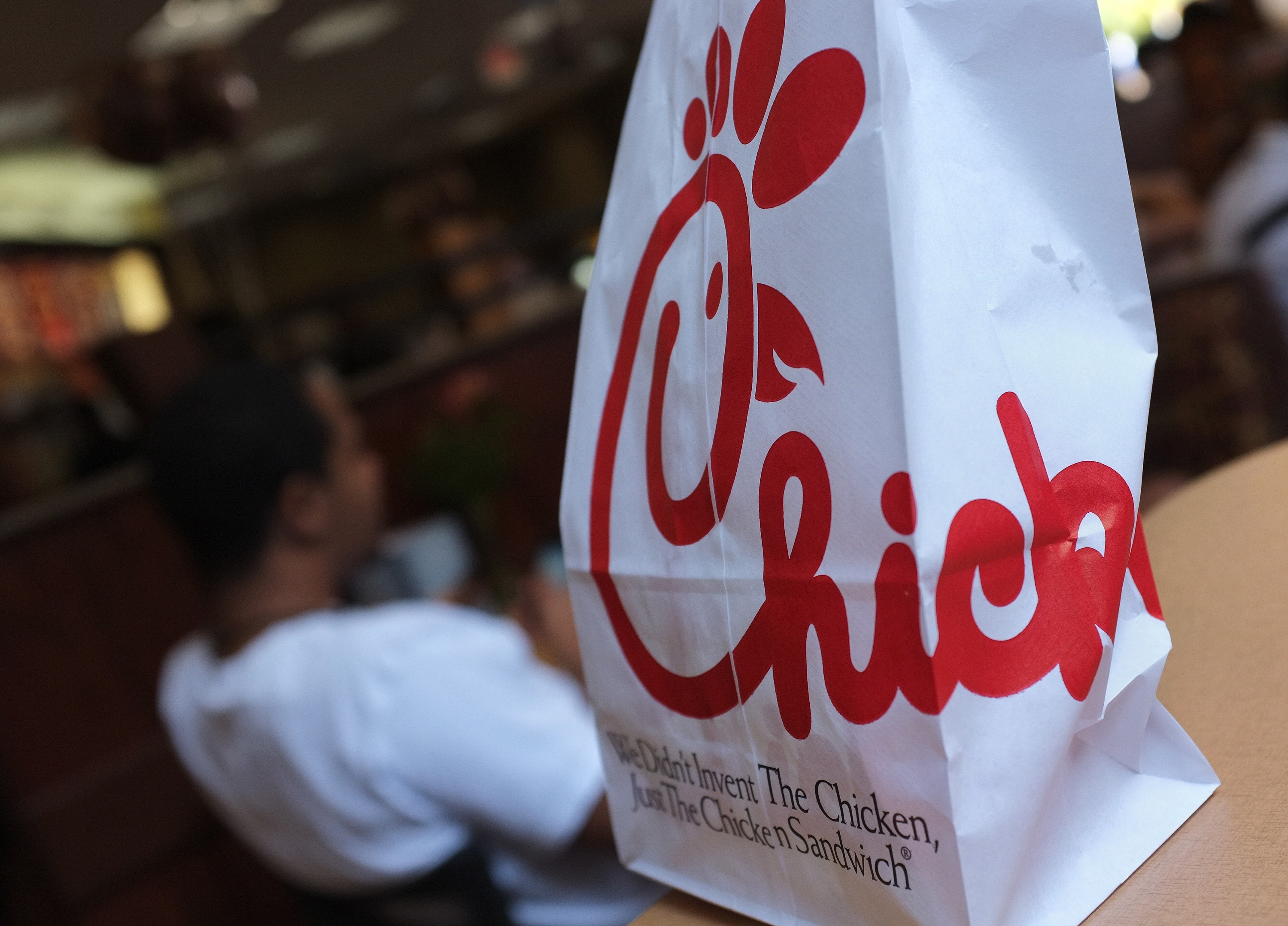 A Chick-fil-A logo is seen on a take out bag