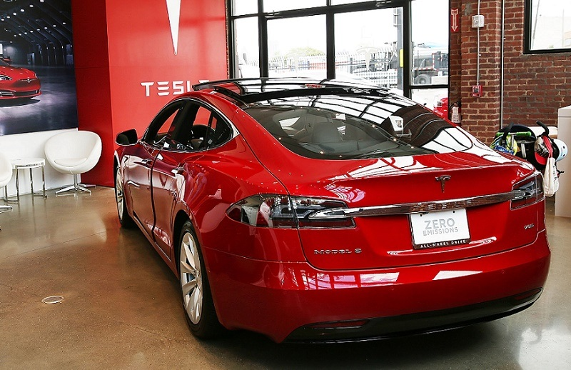 NEW YORK, NY - JULY 05: A Tesla model S sits parked in a new Tesla showroom and service center in Red Hook, Brooklyn on July 5, 2016 in New York City.