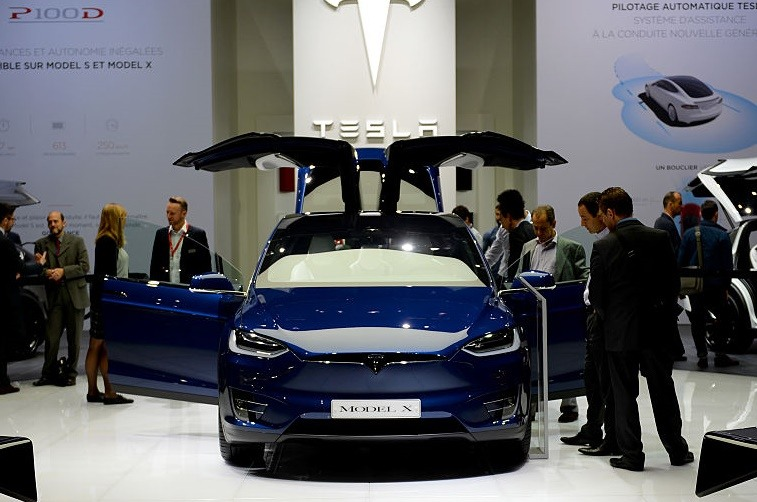 Tesla cars are presented during press days of the Paris motor Show on September 30, 2016. / AFP / ERIC PIERMONT (Photo credit should read ERIC PIERMONT/AFP/Getty Images)