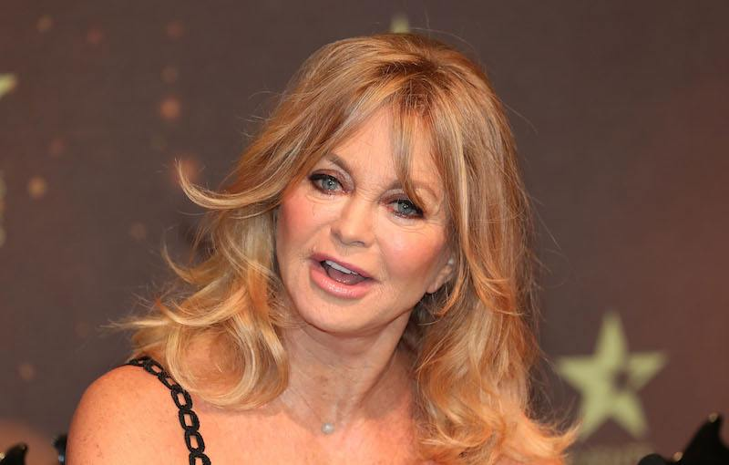 Actress Goldie Hawn tilts her head while speaking