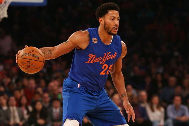 Derrick Rose of the New York Knicks dribbles the ball against the Boston Celtics at Madison Square Garden.