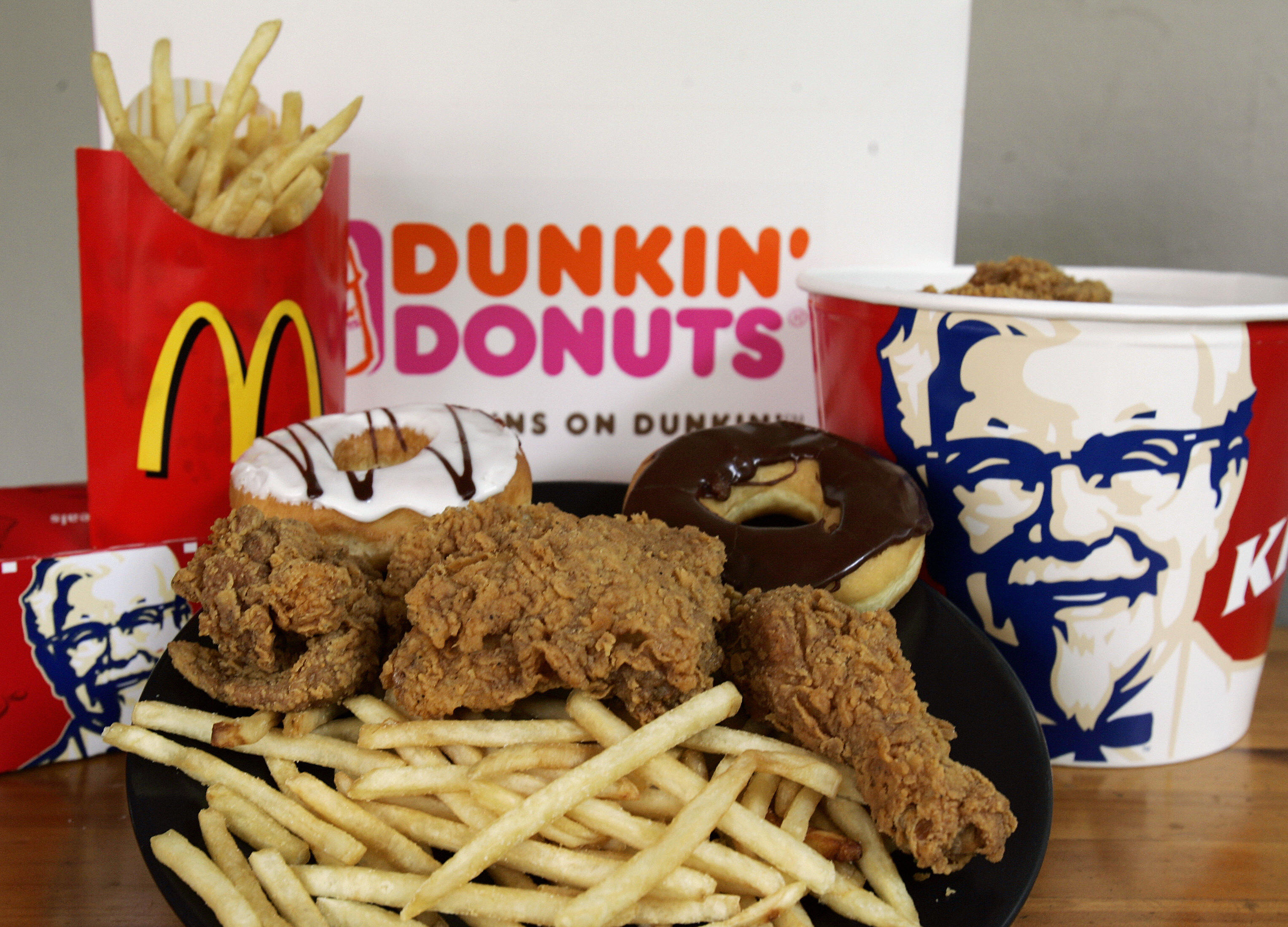 """Doughnuts from Dunkin"""" Donuts, French fries from McDonalds and fried chicken from Kentucky Fried Chicken are displayed as staples of the American diet"""