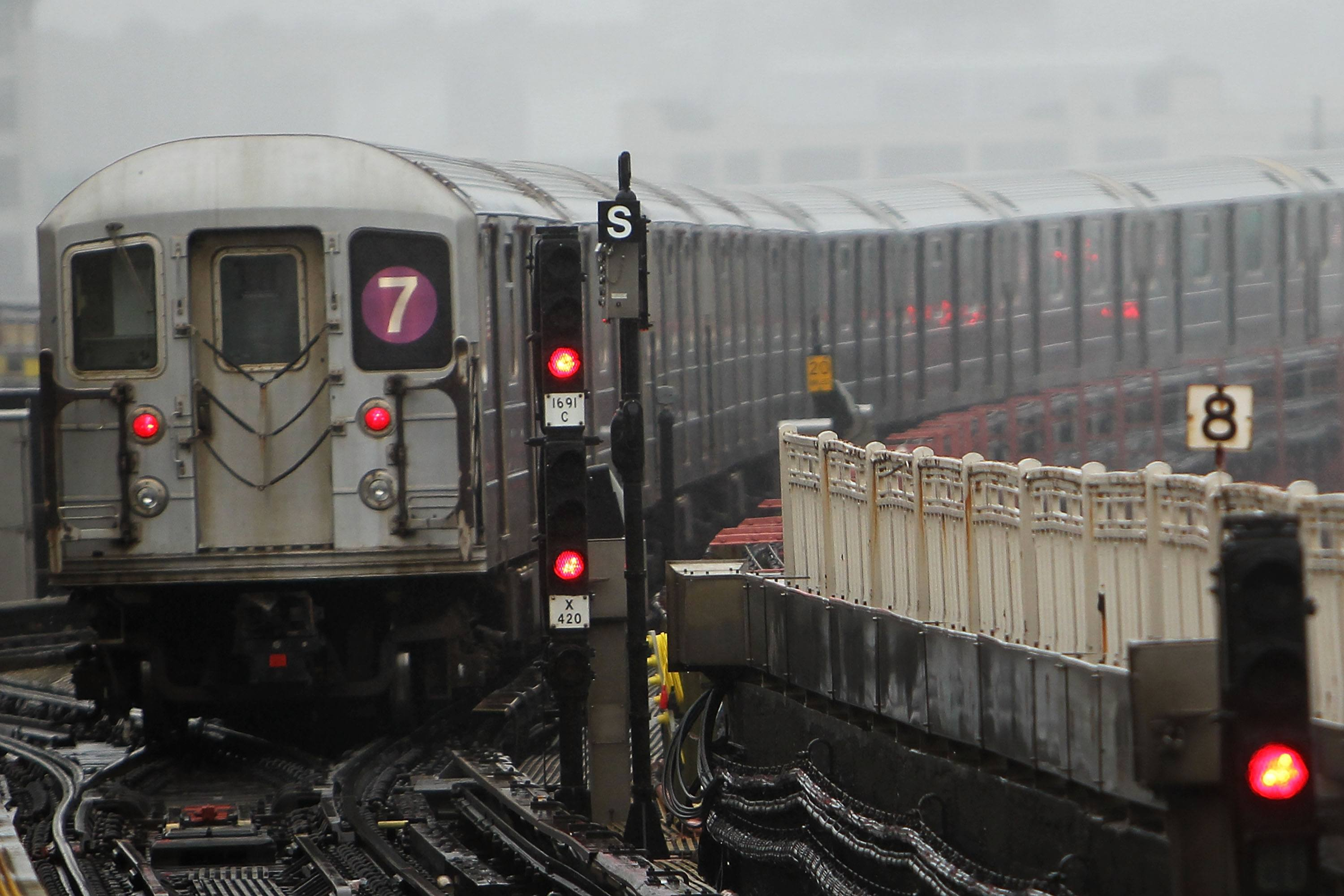 A New York City Subway train pulls away from a station
